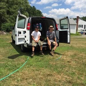 Boys sitting in van